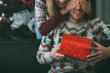Young Woman Surprise Beloved Man With Christmas Present