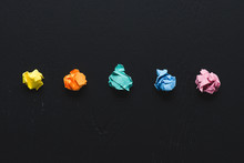 Top View Of Colorful Crumpled Paper Balls On Black Background, Think Different Concept