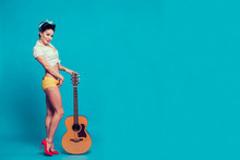 Pin-up Girl Holding The Guitar