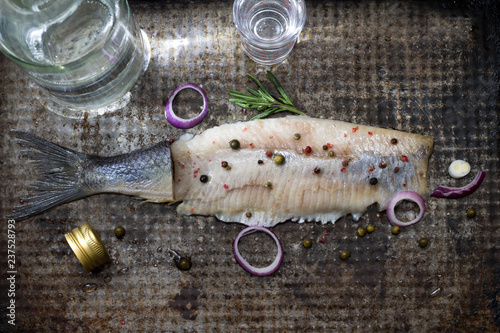 Abstract herring with vodka and glasses creative still life fish like swimming in alcohol