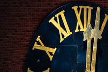 The Clock With Gilded Roman Nu...