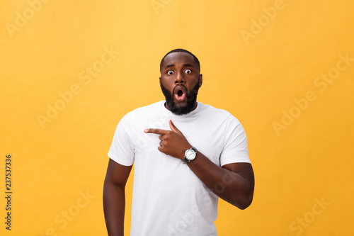 Fotografija  Amazed young African American hipster wearing white t-shirt holding hands in sur
