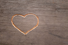 Heart Carved On The Wooden Pla...
