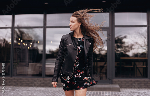 Obraz na plátně Beautiful young woman walk in windy weather. Walking in the city
