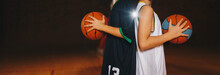 Two Boys Basketball Team Players Holding Basketballs On The Wooden Court. Basketball Training For Kids. Horizontal Background Of Youth Basketball Players, Copy Space