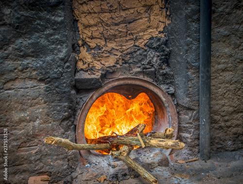 Fotografie, Obraz  Burning fire on an over for producing ceramics, Cuba