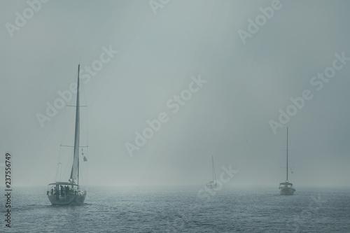 Türaufkleber Schiff Sailing yachts go in the fog. Seascape.