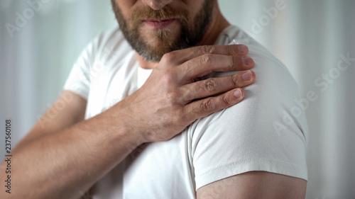 Vászonkép Male suffering from shoulder ache, muscle pain, inflammation sprain problem