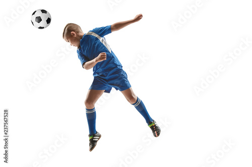a6920f617 Young boy with soccer ball doing flying kick