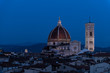 Cityscape, skyline aerial view on Firenze, Italy, Italian city at dark night, twilight, dusk, houses, buildings roofs, rooftops, illuminated Florence Cathedral, Cattedrale di Santa Maria del Fiore