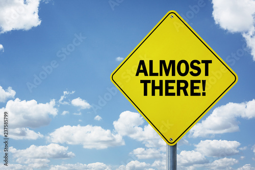Photo  Almost there motivational road sign