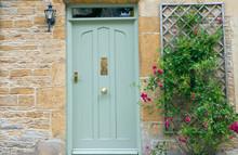 Light Green Wooden Doors In An...