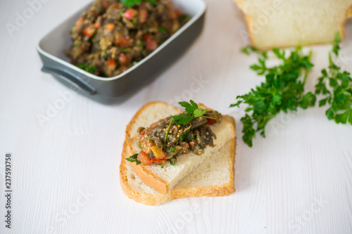 eggplant caviar with tomatoes and a slice of bread