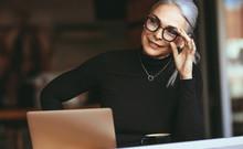 Senior Businesswoman Thinking At Cafe