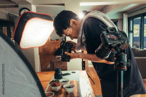 Photographer making vlog on food photography