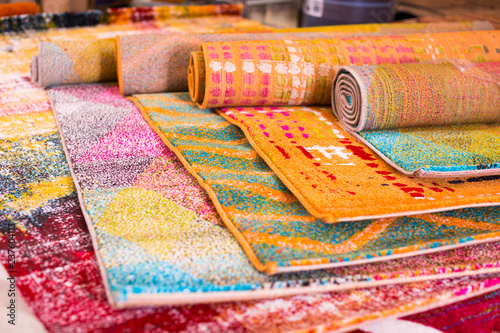Fotografie, Obraz  Various colorful wool rugs for sale at store