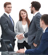 handshake business partners after signing a contract