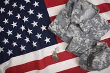 Combat Uniform Dog Tags And American Flag