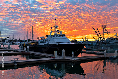 Sunrise with commercial fishing boat at California marina