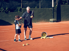 Old Man And Boy With Tennis Ra...