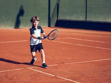 Boy Playing Tennis On Hard Court