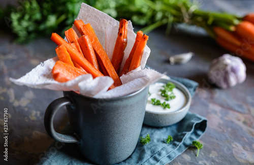 Fototapeta Carrot fries with sour cream and garlic dip obraz