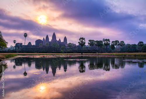 Foto op Plexiglas Asia land Amazing view of Angkor Wat temple at sunrise. The temple complex Angkor Wat in Cambodia is the largest religious monument in the world. Location: Siem Reap, Cambodia. Artistic picture. Beauty world
