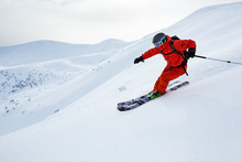 A Man Is Skiing On The Slope.