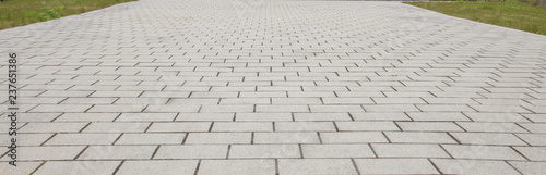 Fototapeta interlocking stone block walkway