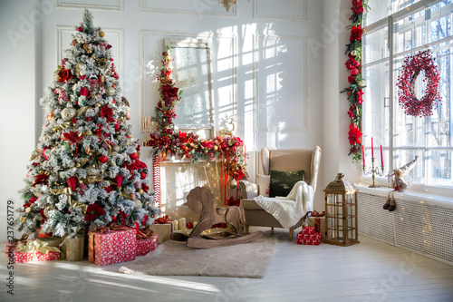 White room interior in red tones with New Year tree decorated, present boxes and Fototapete