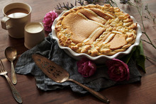 Baked Pumpkin Pie With Leaf Patterned Crust Coffee And Cream On Wood Table  Vintage Utensils