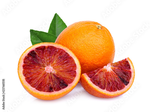whole and slices blood orange with green leaf isolated on white background