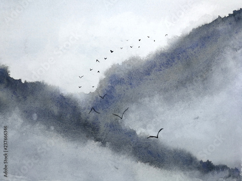 Papiers peints Gris watercolor misty landscape mountain fog and birds flying in the sky. traditional oriental ink asia art style