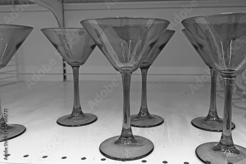 black and white transparent glasses for alcohol on the shelf......