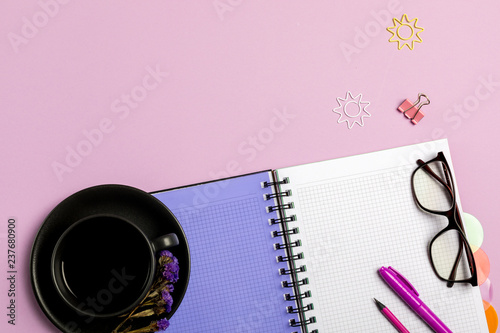 Foto  Flat lay composition with stationery on pink background