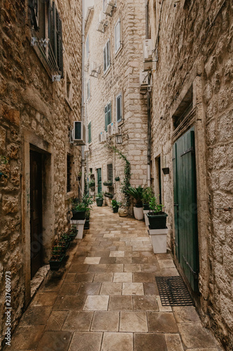 small-street-in-an-old-european-city-with-narrow-aisles