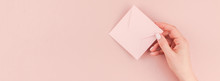 Woman Hand Holding Small Pink Love Letter