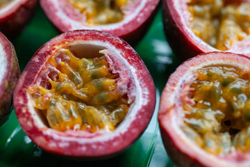 Passion fruit cut in half on green grass close up