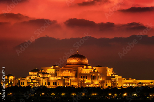 Canvas Prints Abu Dhabi Beautiful sunset over the uae presidential palace in Abu Dhabi. The clouds look like mountains in the background.