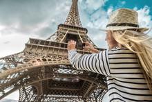 Woman Tourist Selfie Near The Eiffel Tower In Paris Under Sunlight