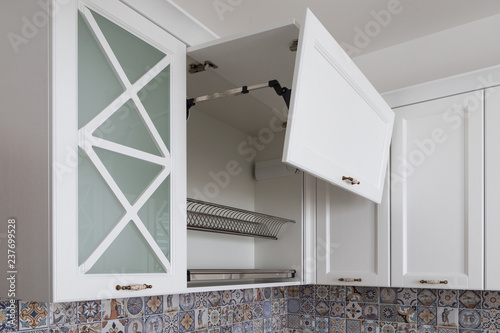Kitchen cabinet with opened fronts with dish holder shelves ...