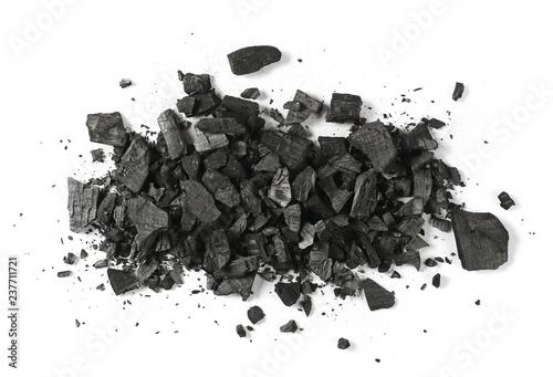 Poster Firewood texture Black charcoal pile isolated on white background, top view
