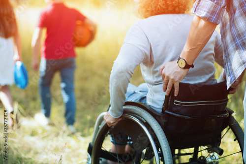 Photo  Close up look on woman's back in a wheelchair.