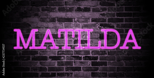 Photo  first name Matilda in pink neon on brick wall