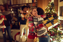 Happy Girlfriends Celebrating Christmas Together.