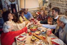 Large Family Clinking Glasses On Christmas Dinner.
