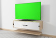 Smart Tv Mockup with blank green screen hanging in modern white empty room interior minimal designs. 3d rendering