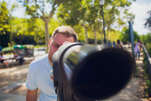 Young Man Binocular Against Observation Deck View.
