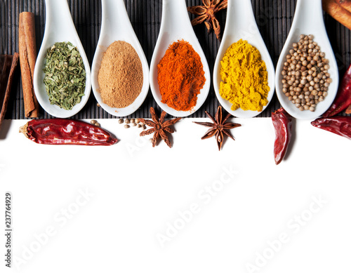 Photo Stands Herbs 2 Top view on mixed dry colorful spices isolated on white background.
