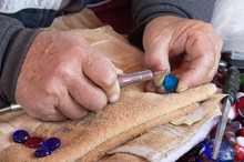 Craftman Making Decoration On Crystal Using A High Speed Rotary Multi Tool